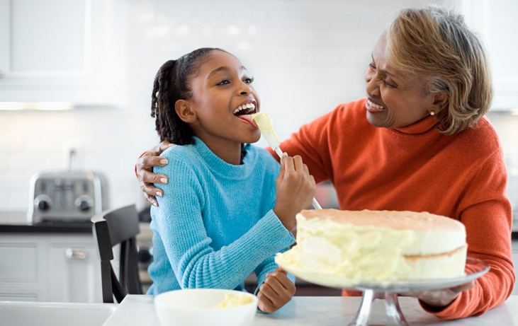 woman making cake with granddaughter