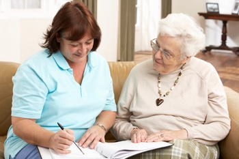 Discussing care with a senior woman