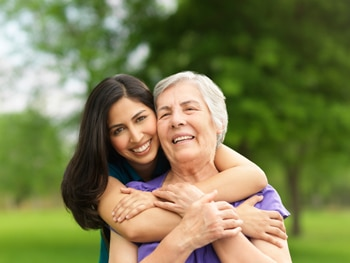 Elderly woman and female caregiver