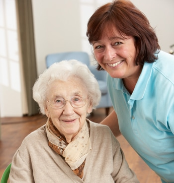Older woman next to caregiver