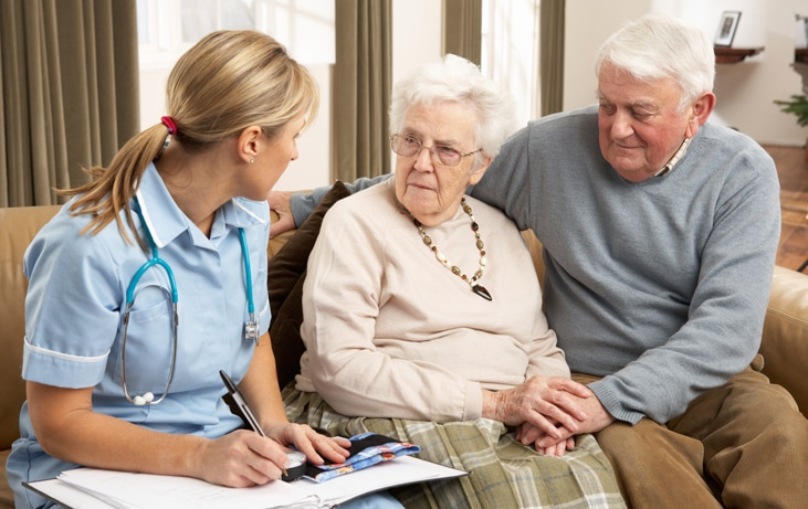 an elderly couple in a consultation with a nurse