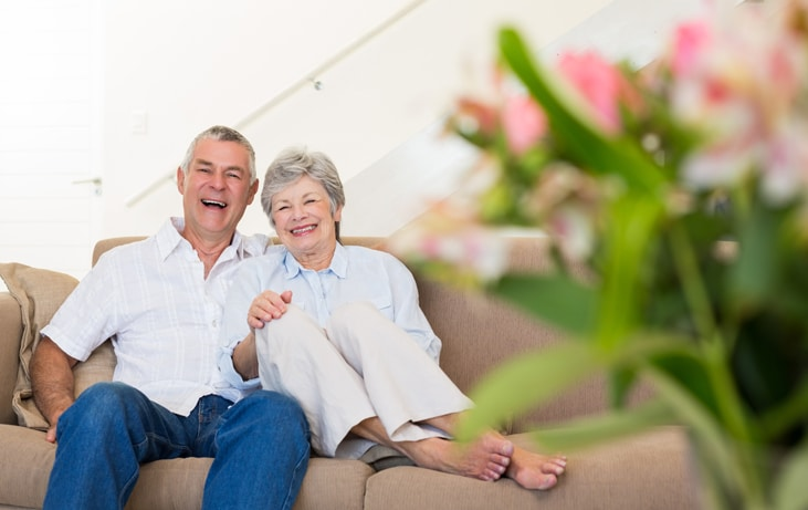 happy elderly couple on a couch