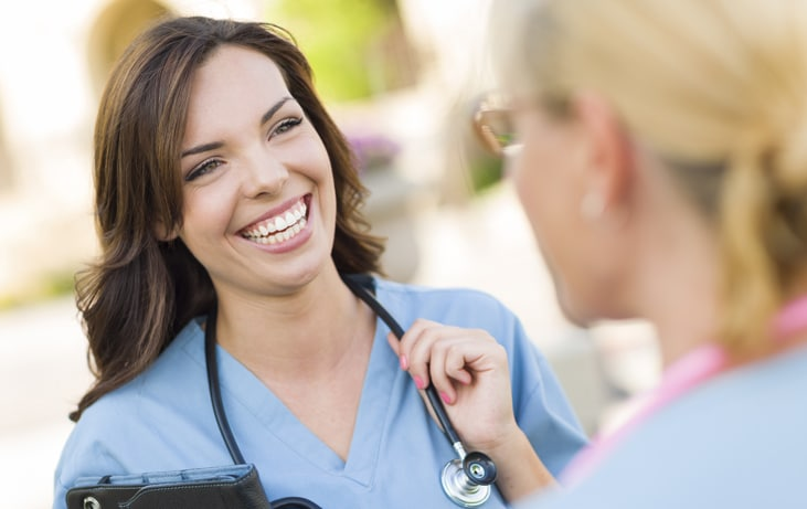 nurse speaks with a woman
