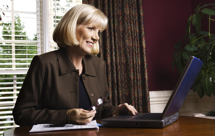 business woman in office using laptop