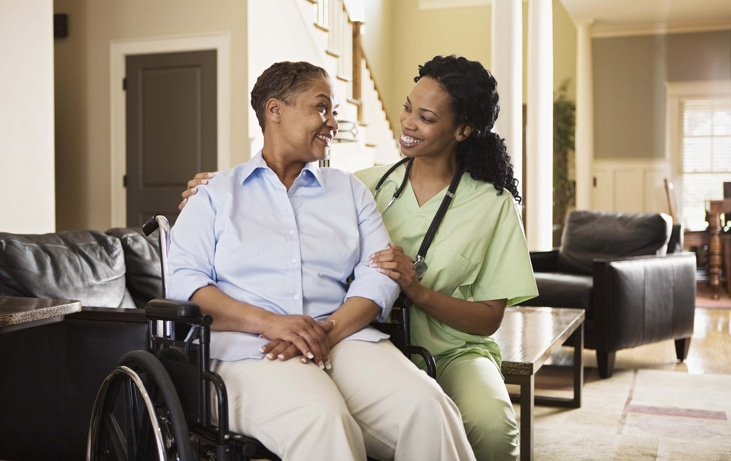senior woman in wheelchair with her female caregiver
