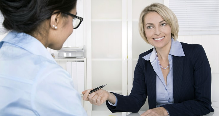 """""""Female-boss-meeting-with-employee-</p"""