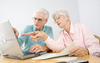 Older-couple-using-laptop-feat