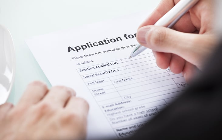 Person filling out application form
