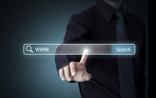 man touching giant search bar