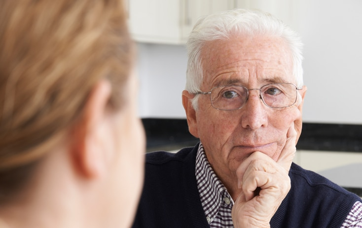 provider and caregiver in a meeting
