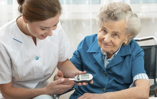 caregiver with a diabetic woman