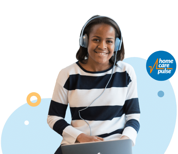 Young person smiling at computer